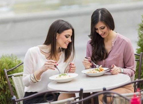 Women talking eating salad
