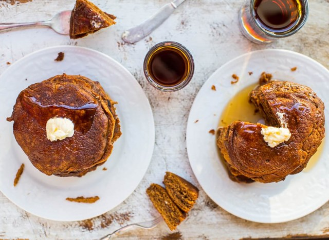 gingerbread molasses pancakes on plates with butter and syrup