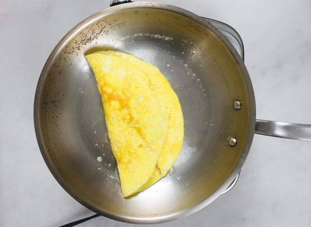 flipped omelet on a pan