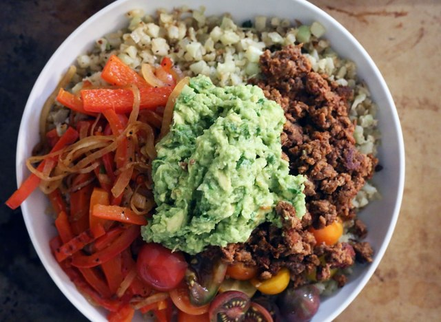 whole 30 burrito bowl with guacamole on top