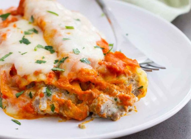 ground beef stuffed manicotti on white plate taste and tell recipe