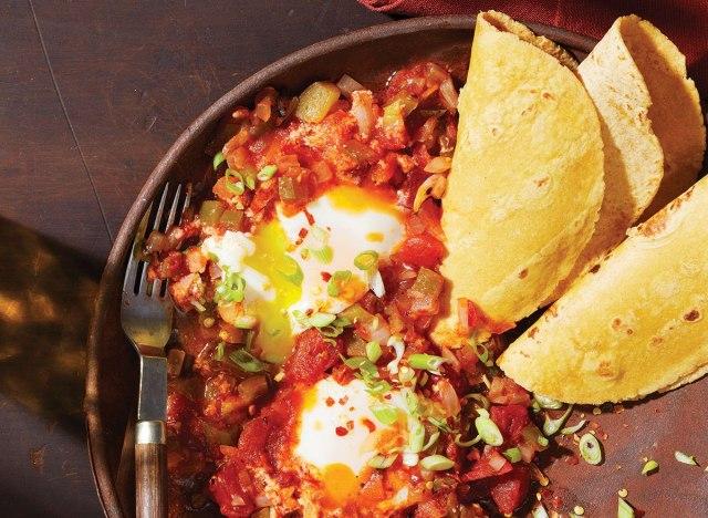 eggs diablo with taco shells in pan