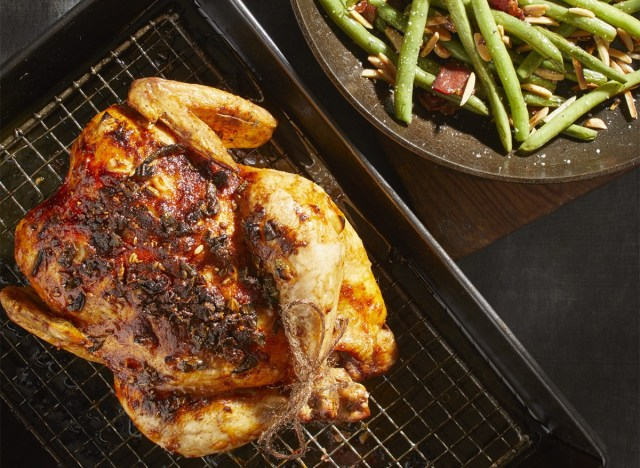 keto roast chicken on cooling rack with stringbeans