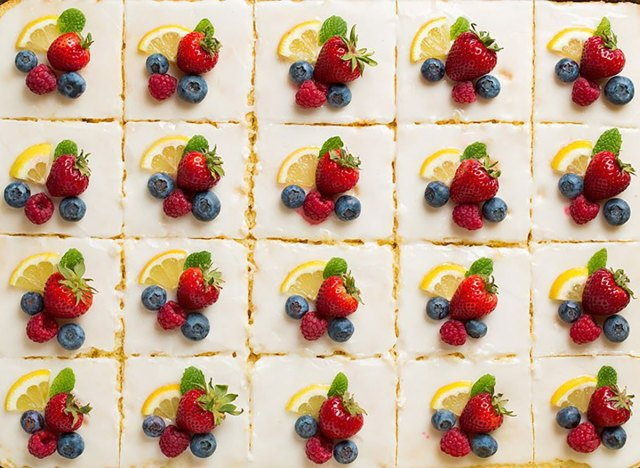 slices of lemon sheet cake topped with fresh fruit