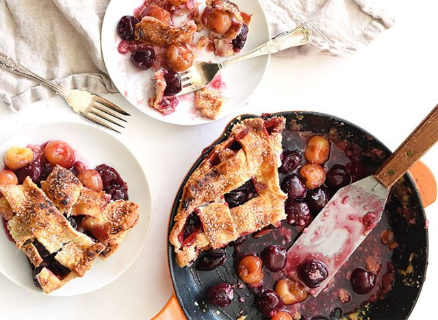 skillet cherry pie with slices on plates
