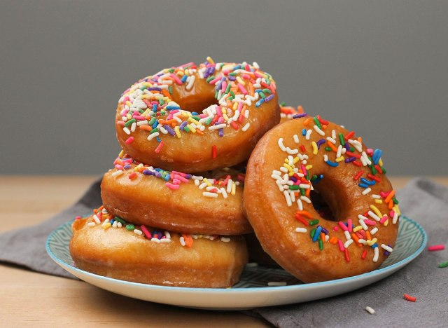 homemade old fashioned donuts with sprinkles on a plate