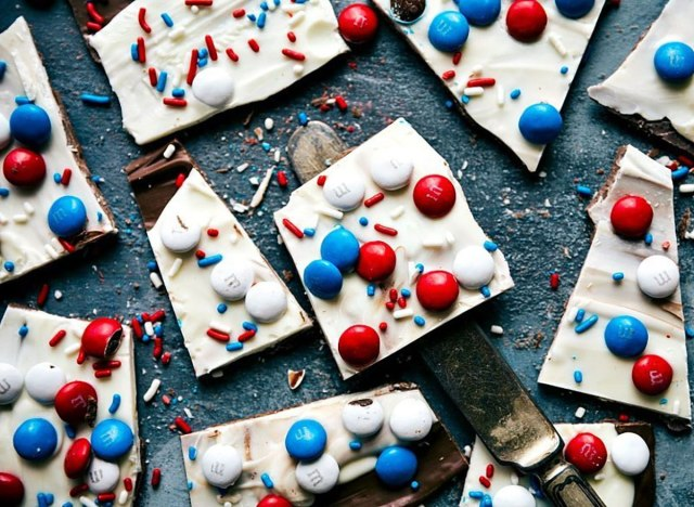 milk and white chocolate bark with red white and blue m&ms and sprinkles