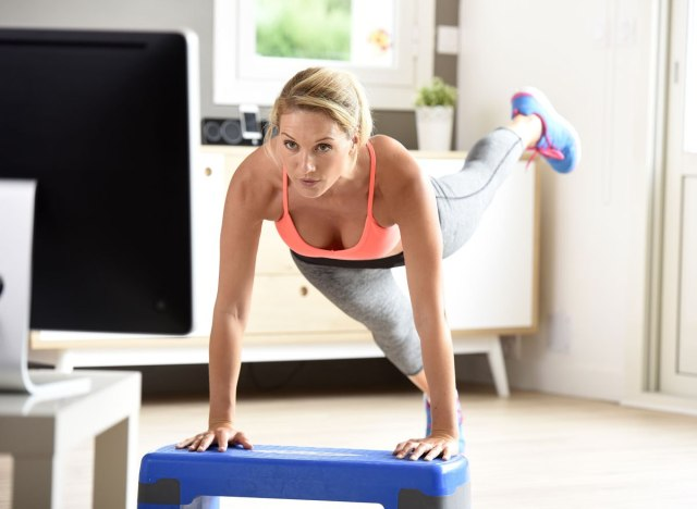 woman working out in front of tv