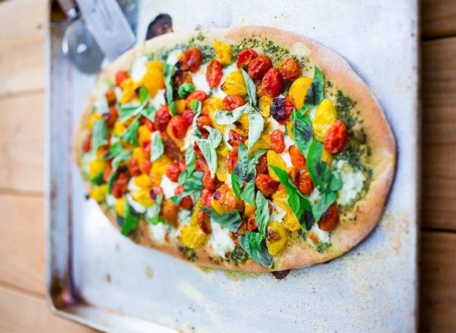 caprese pizza on baking tray