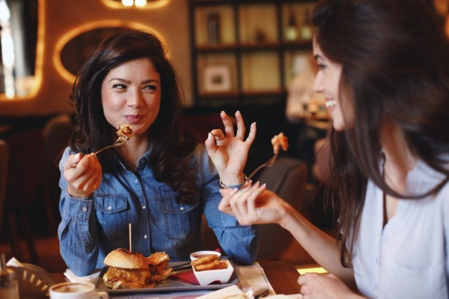 Two young women at a lunch in a restaurant