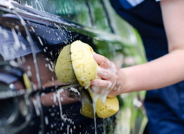 Woman washing a car
