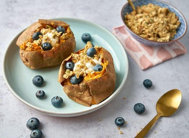 breakfast sweet potato on blue plate with blueberries and yogurt