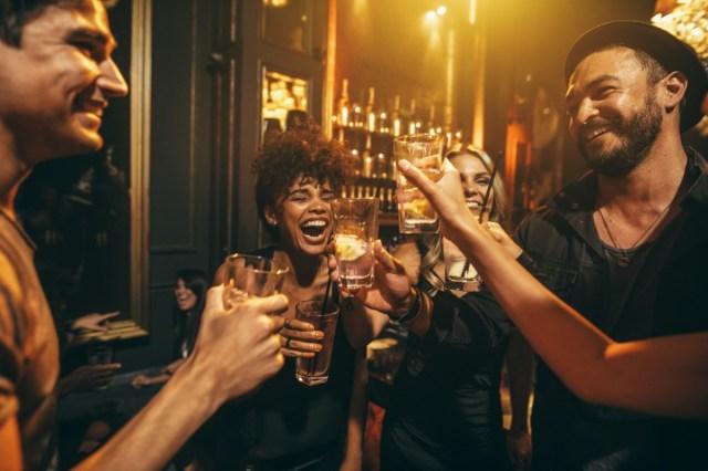 Group of friends having drinks at nightclub.