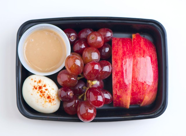 protein snack box with peanut butter egg grapes apples