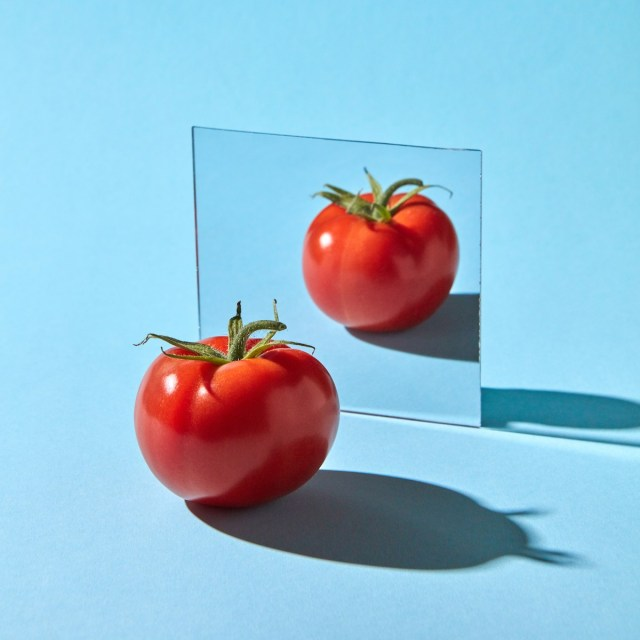 tomato in front of a mirror