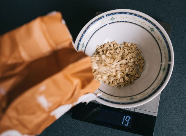 Pouring oats into bowl to measure portion on scale