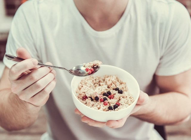 man holding bowl of oatmeal