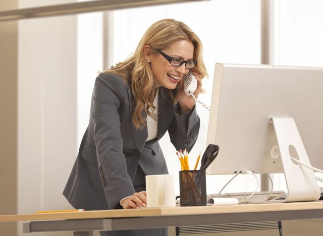 Woman with office standing desk