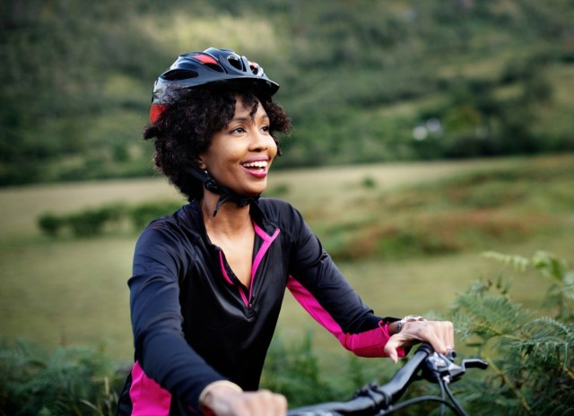 Cheerful female cyclist enjoying a bike ride