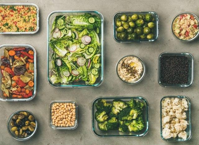 Vegetarian vegan meal prep with vegetables beans salad olives hummus
