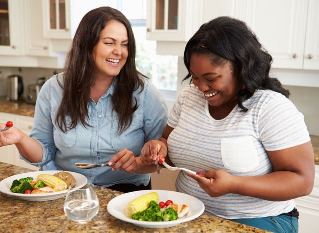 Overweight women eating