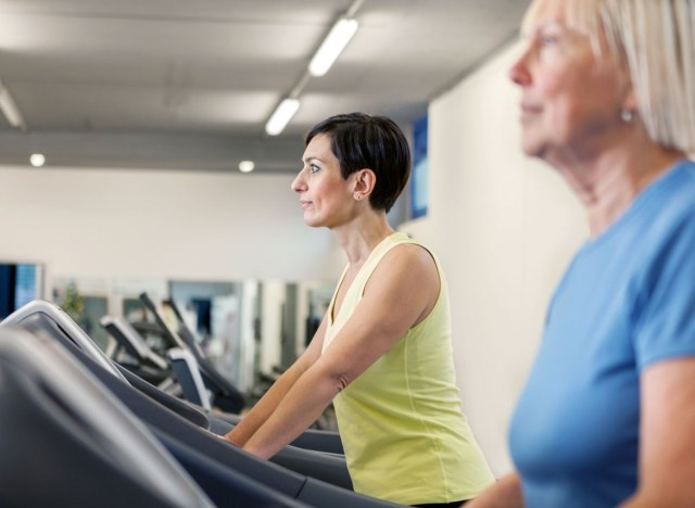 woman walking on treadmill unhappy