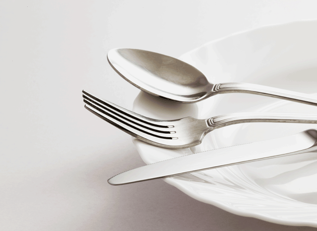 spoon for knife utensils on white glass plate