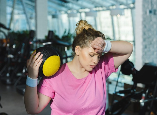 woman sweating and tired after exercising a workout