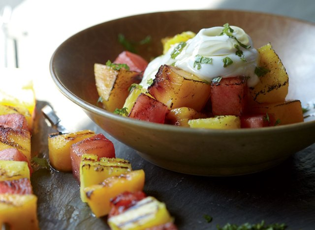 Healthy grilled fruit kebabs with yogurt and honey