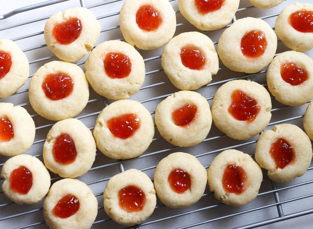 jelly thumbprint cookies on a cooling rack