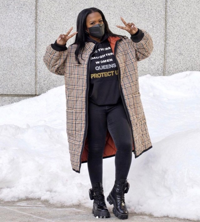 kandi burruss in burberry coat, black leggings, black sweatshirt, and black mask flashing peace