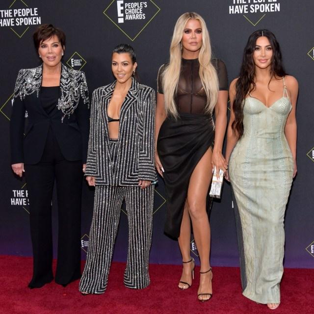 kris jenner, kourtney kardashian, khloe kardashian, and kim kardashian on red carpet