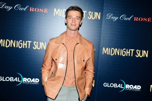 patrick schwarzenegger in tan leather jacket on red carpet