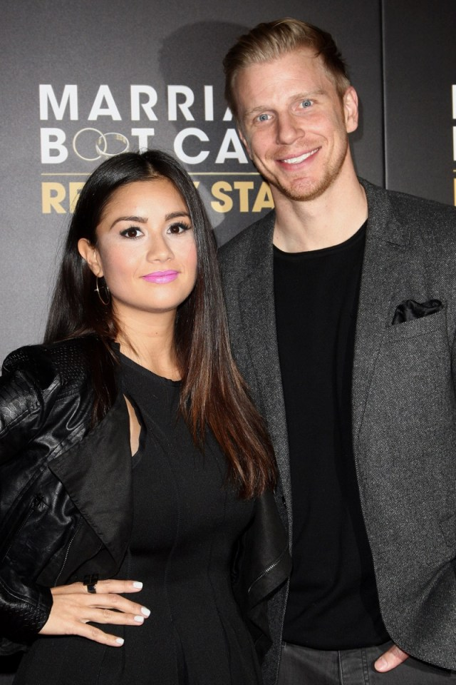 catherine giudici and sean lowe smiling on red carpet
