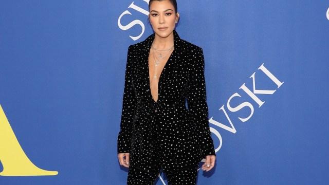 kourtney kardashian in black suit with white spots