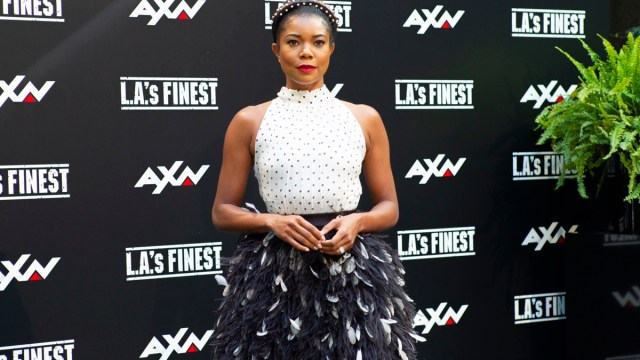 gabrielle union in white sleevelss top and black skirt